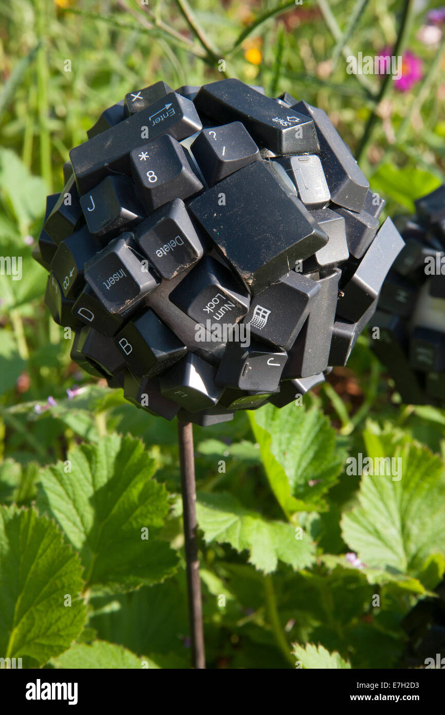 Garden - Digital Green - garden ball made from recycled reused computer keyboard keys eco use - Designers - Clu - Stock Image