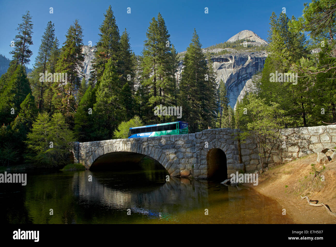 Bus on Stoneman Bridge over Merced River, Yosemite Valley, Yosemite National Park, California, USA - Stock Image