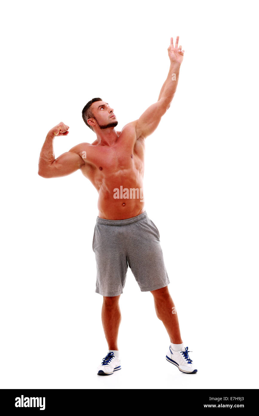 Handsome sportsman posing over white background - Stock Image