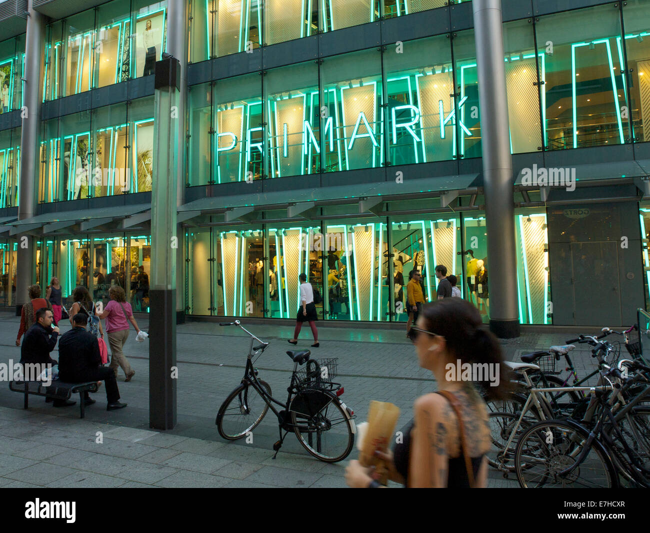 large Primark store in the city center of Cologne, NRW, Germany, with tattooed girl passing - Stock Image