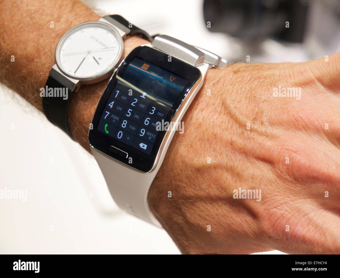 Trying on the latest Samsung smartwatch to see how it compares to a normal watch. Cologne, Germany - Stock Image