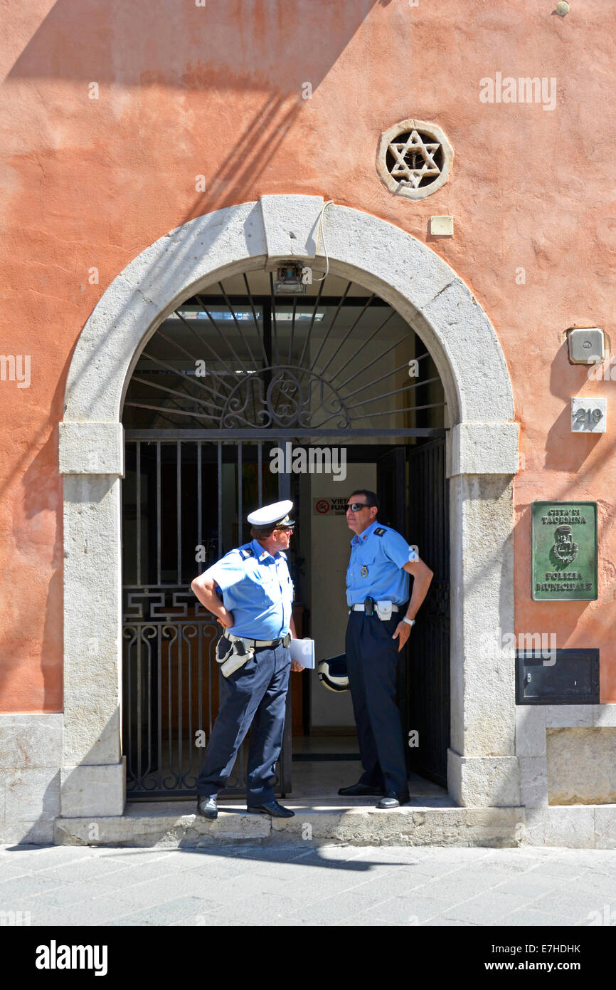 Two police officers at the Polizia Municipale station entrance in Corso Umberto Taormina Province of Messina Sicily - Stock Image