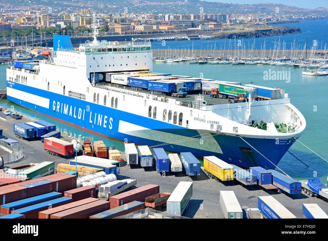 Close up of tug tractor units loading unloading lorry trailers on top open deck of Grimaldi Lines 'Eurocargo - Stock Image