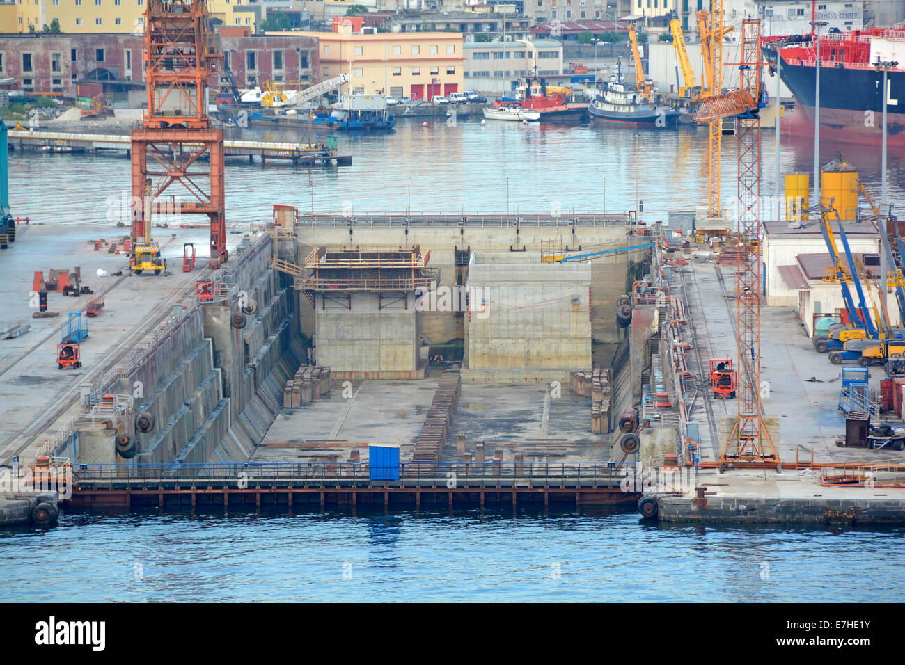 Port of Naples early evening view of empty dry dock after workers had left for the day - Stock Image