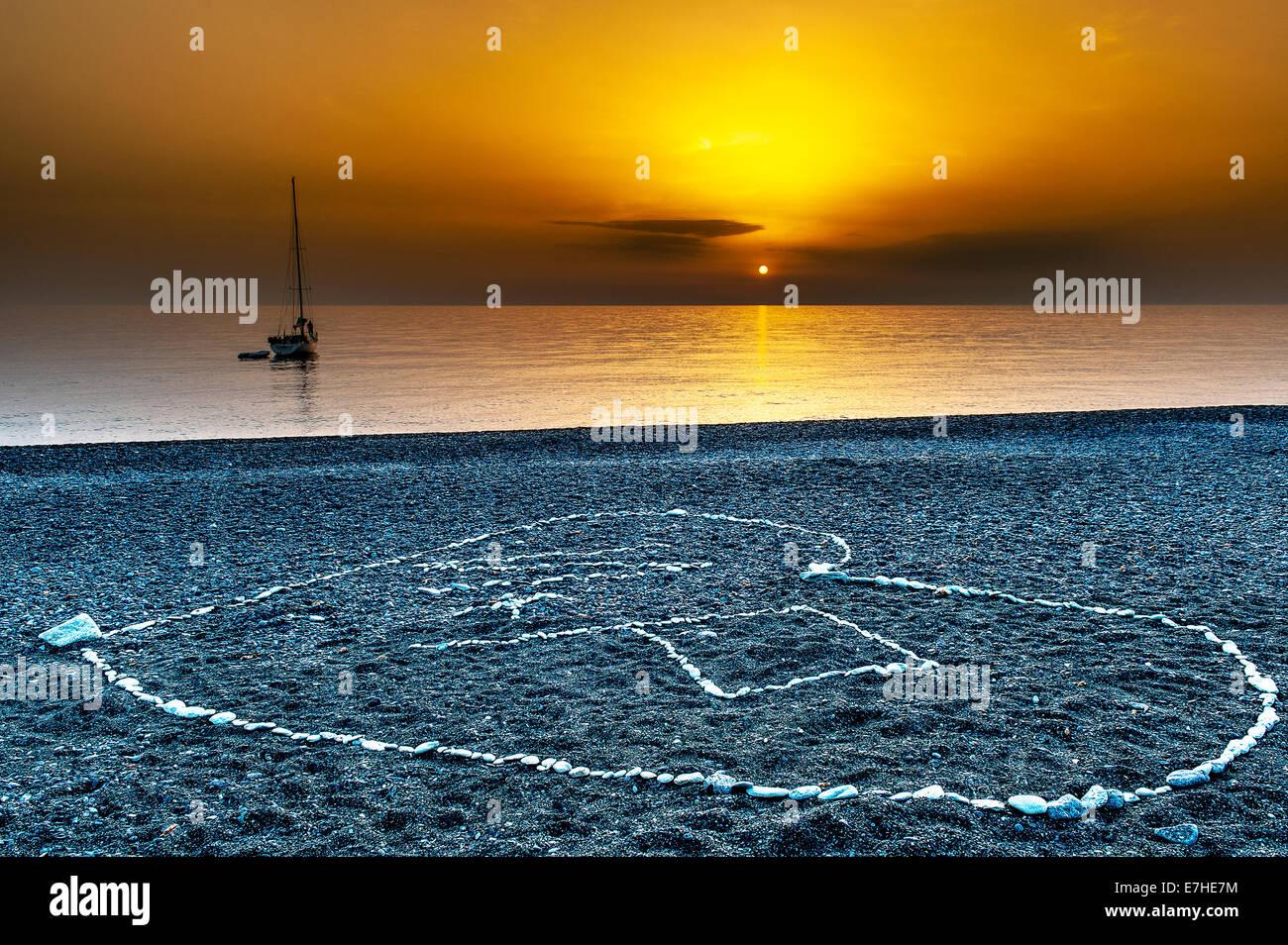 Europe, France, Corsica, Haute Corse, Cap Corse. Nonza. Drawing heart shape on the black pebble beach. - Stock Image