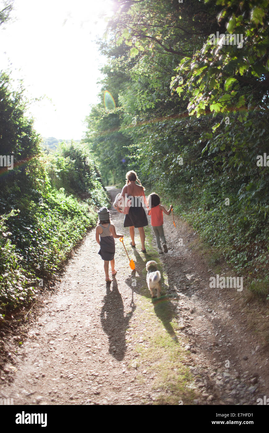 A family walk home from the beach in Devon UK - Stock Image