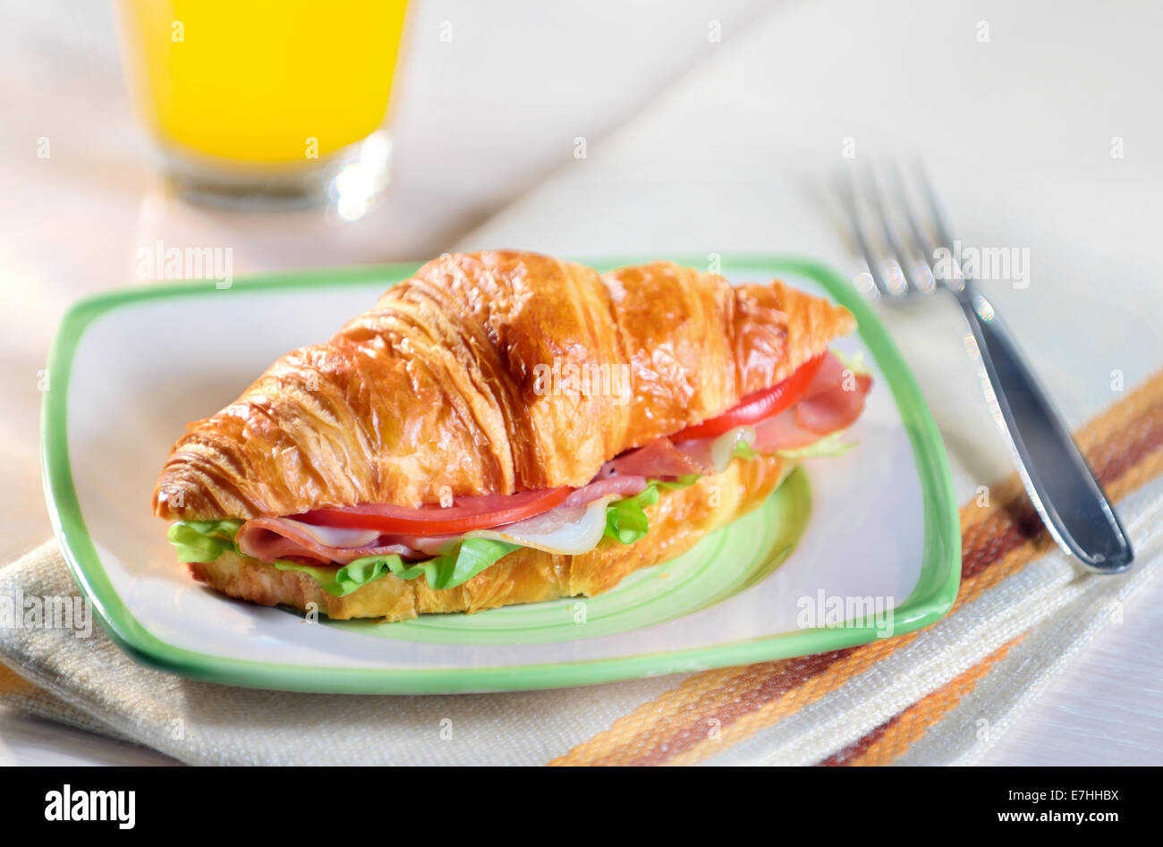 croissant sandwich with ham and vegetables - Stock Image
