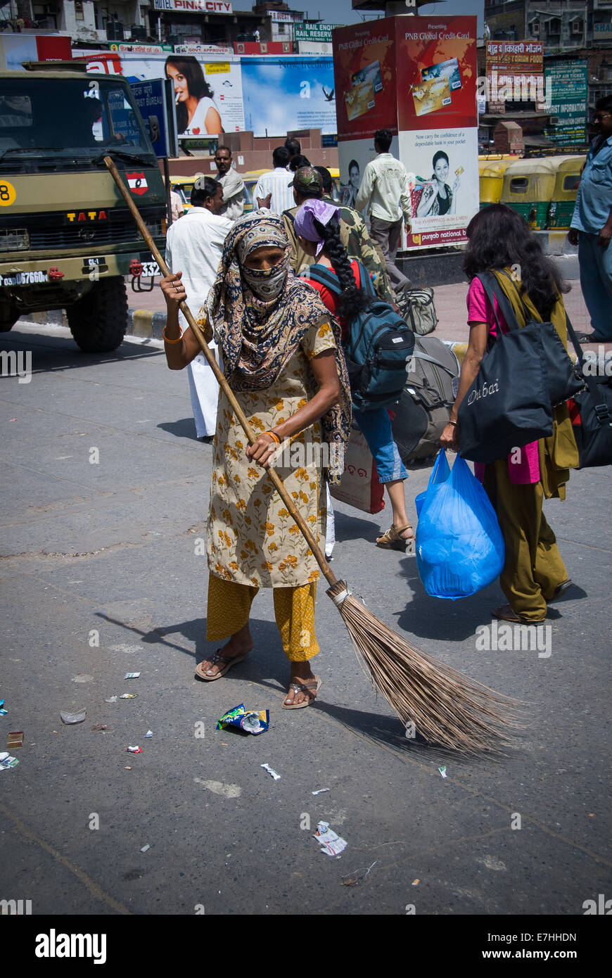 Dalit street cleaner from untouchable caste brushing street in delhi india - Stock Image