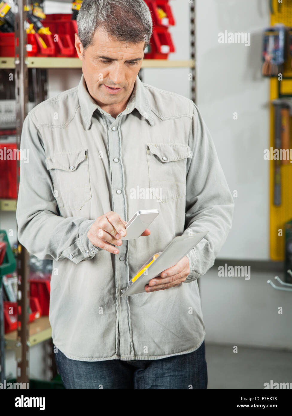 Customer Scanning Tool Packet Through Cellphone - Stock Image