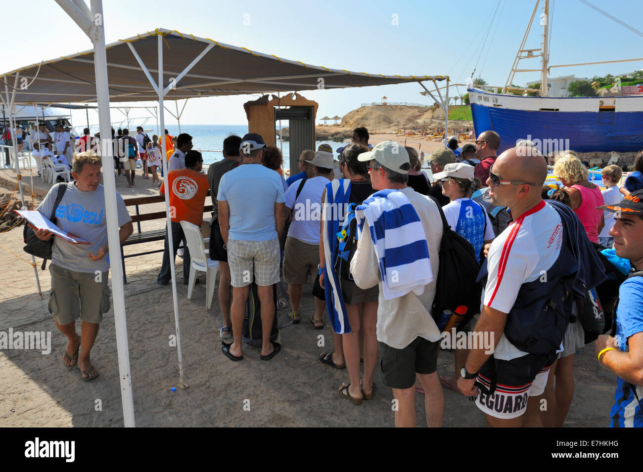 Scuba divers queuing for security checks before boarding boats at 'Sharks Bay' in Sharm El Sheikh by the - Stock Image