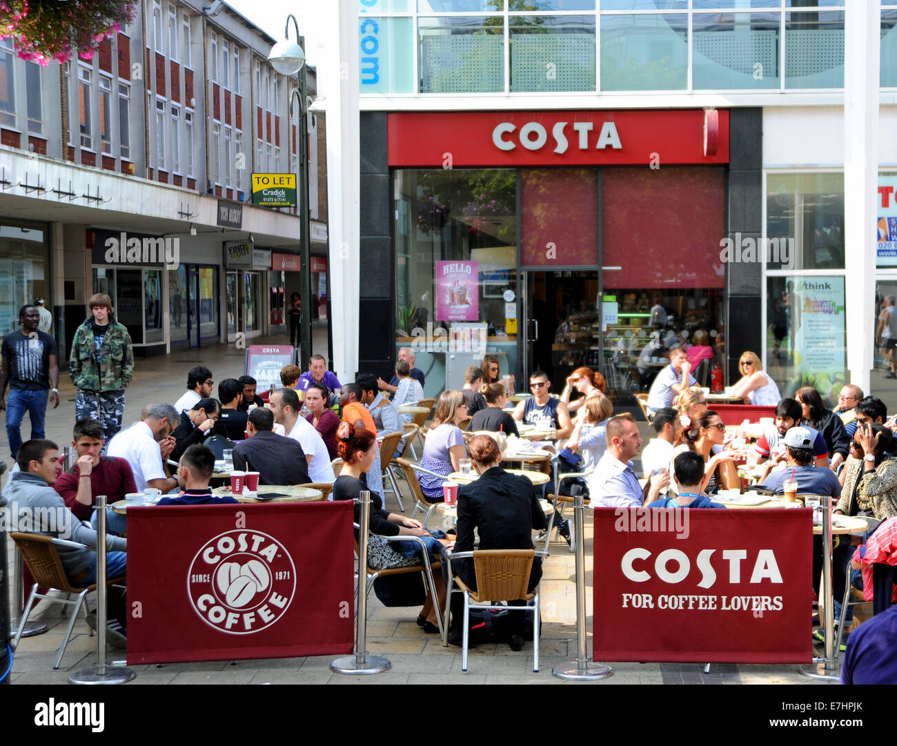 Crawley West Sussex UK - Costa Coffee cafe with people sitting outside in hot weather - Stock Image