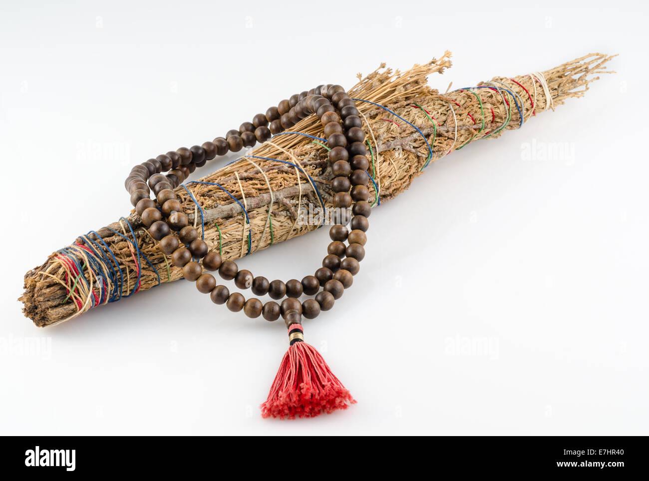 Buddhist Mala Prayer Beads with Pueblo Indian Smudge stick. - Stock Image