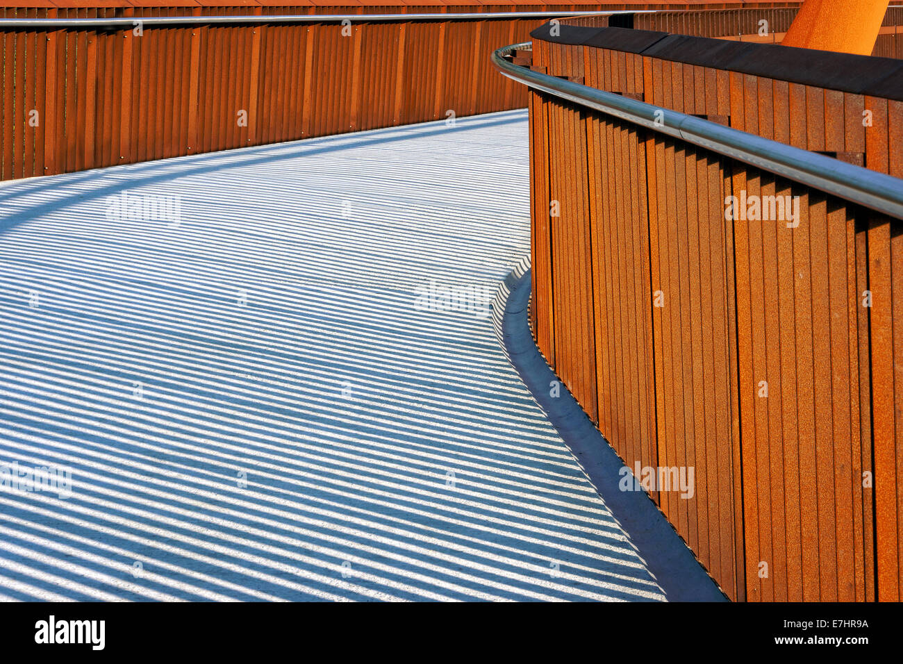 pedestrian bridge with handrail and shadows - Stock Image