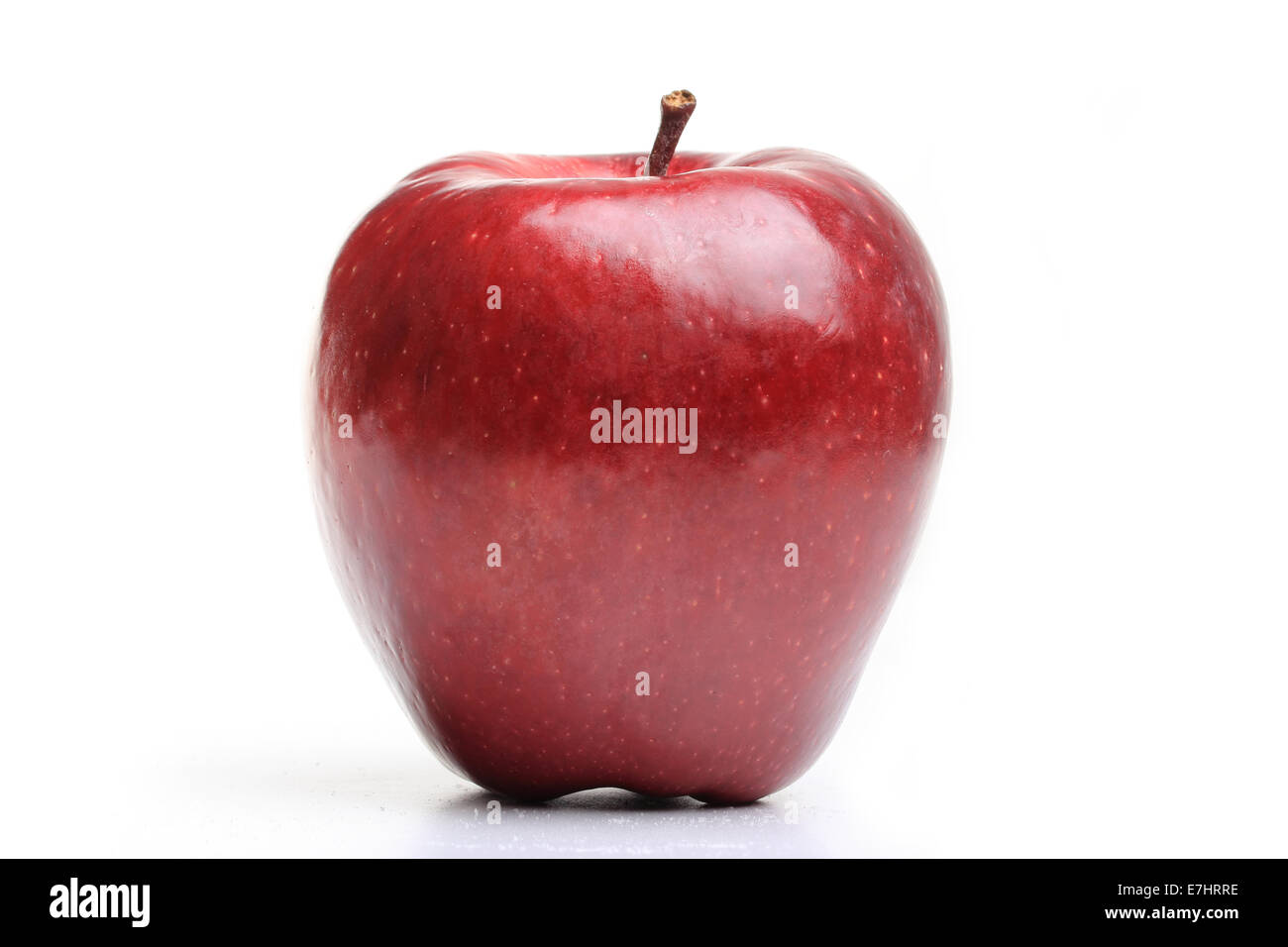individual strong, red apple with white background - Stock Image