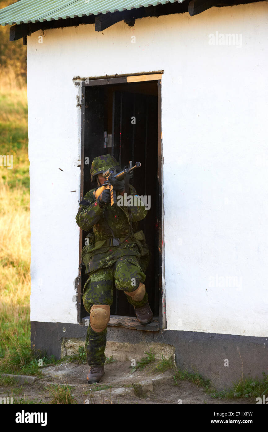 Viborg, Denmark, Thursday 18 April 2014: during city combat training exercises, a Danish soldier fires blanks with - Stock Image