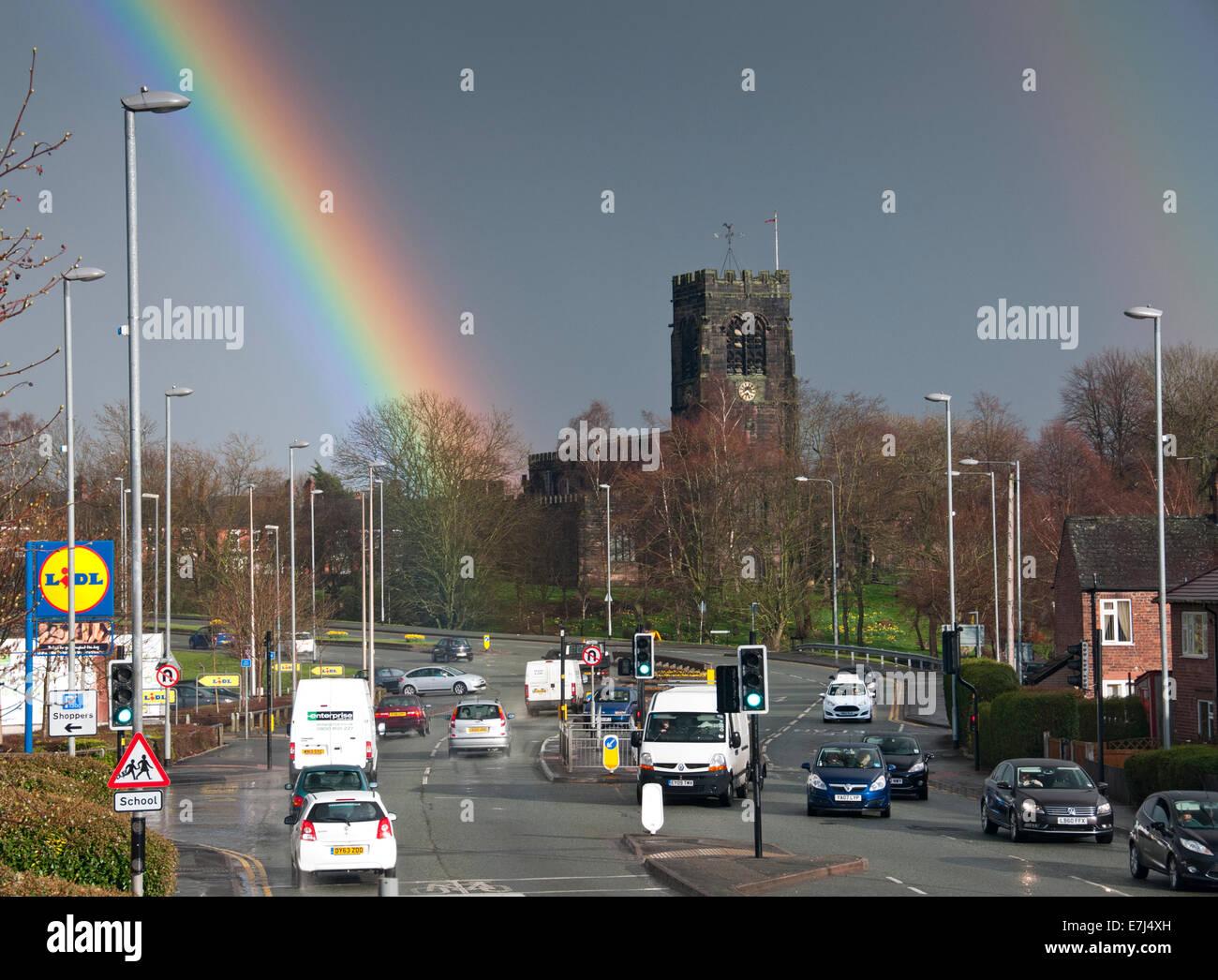 Intense Rainbow Over Northwich Parish Church, Northwich, Cheshire, England, UK - Stock Image