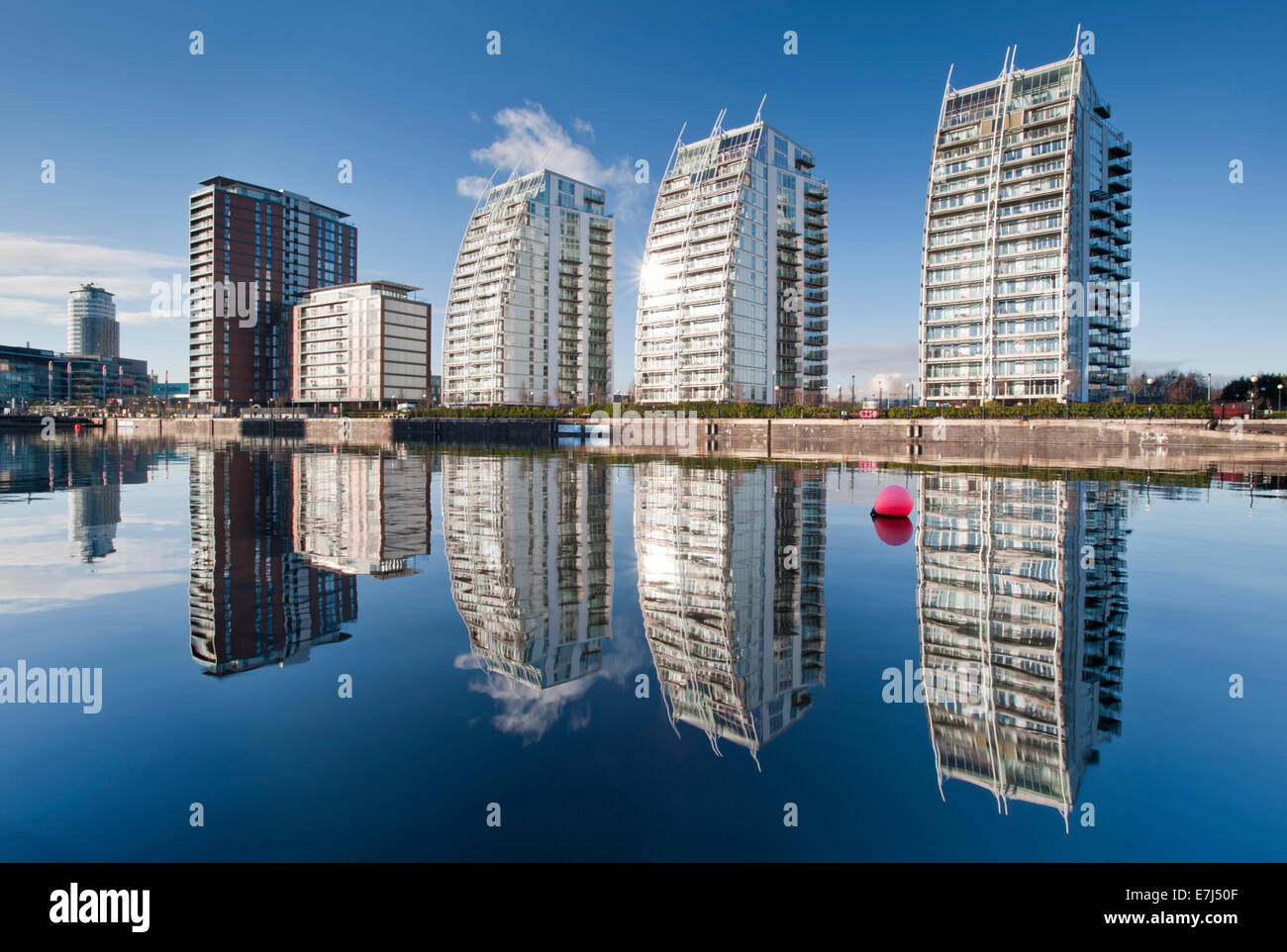 The NV Apartments Viewed Across Huron Basin, Salford Quays, Greater Manchester - Stock Image