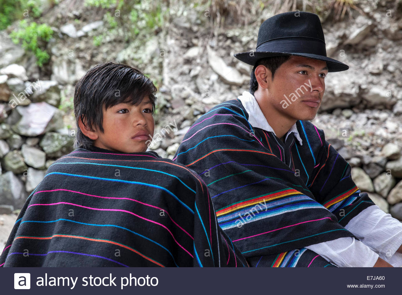 Boy and a man wearing ponchos, Ecuador Stock Photo