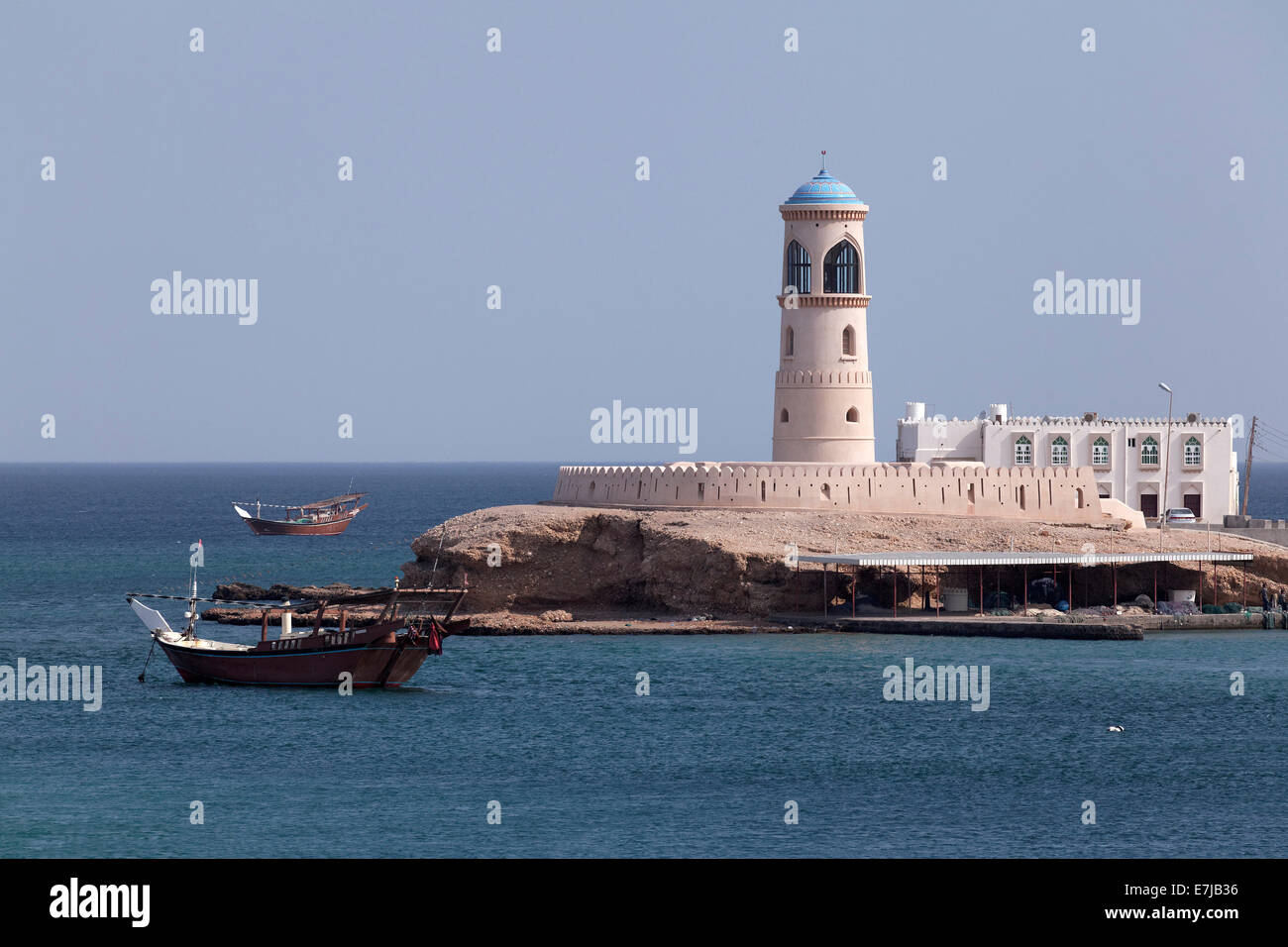 Dhow-ship in front of a lighthouse, Al Ayjah, Sur, Ash Sharqiyah province, Sultanate of Oman, Arabian Peninsula - Stock Image