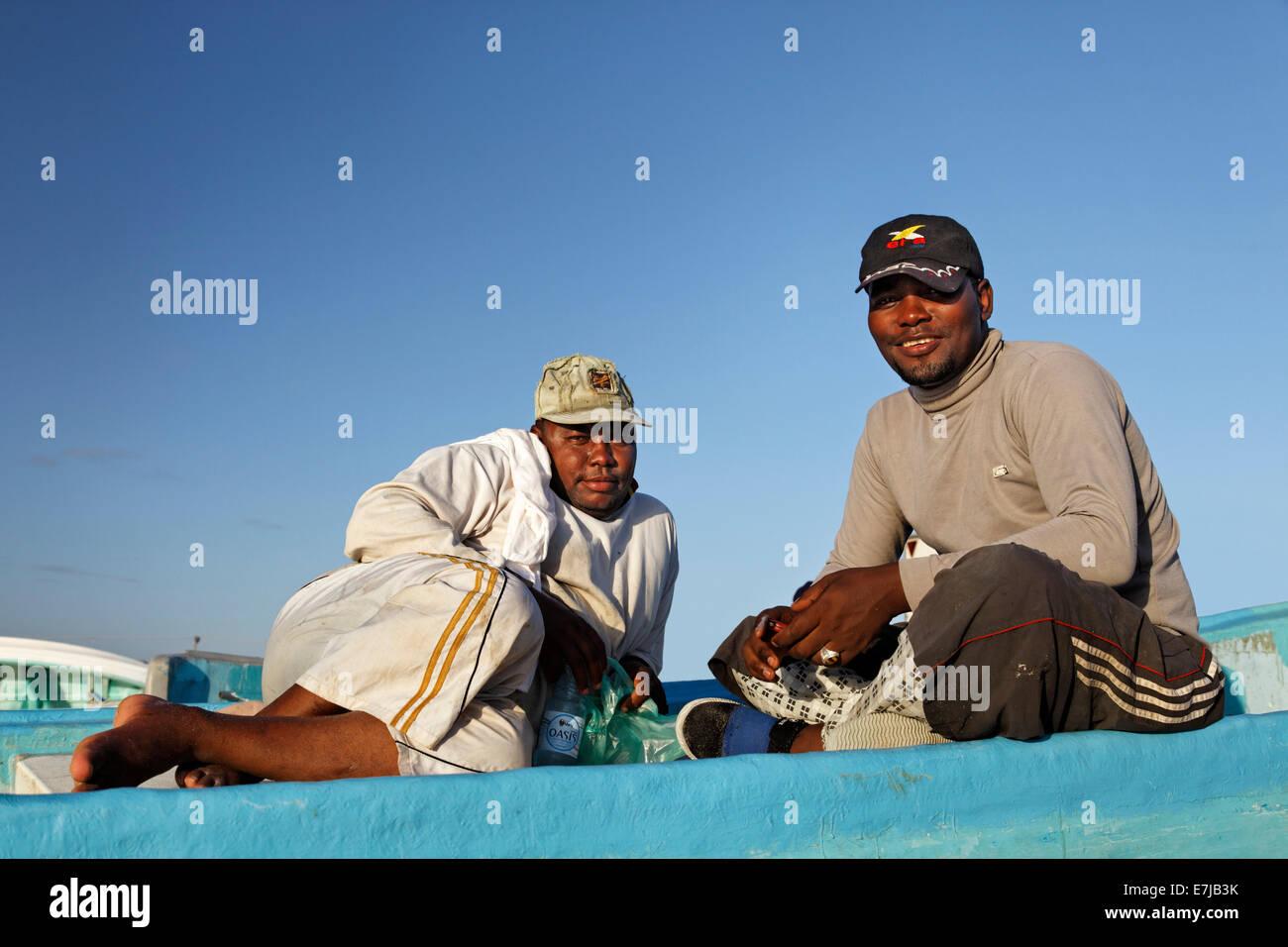 Omani fishermen on a fishing boat, Mirbat, Dhofar region, Sultanate of Oman, Arabian Peninsula - Stock Image