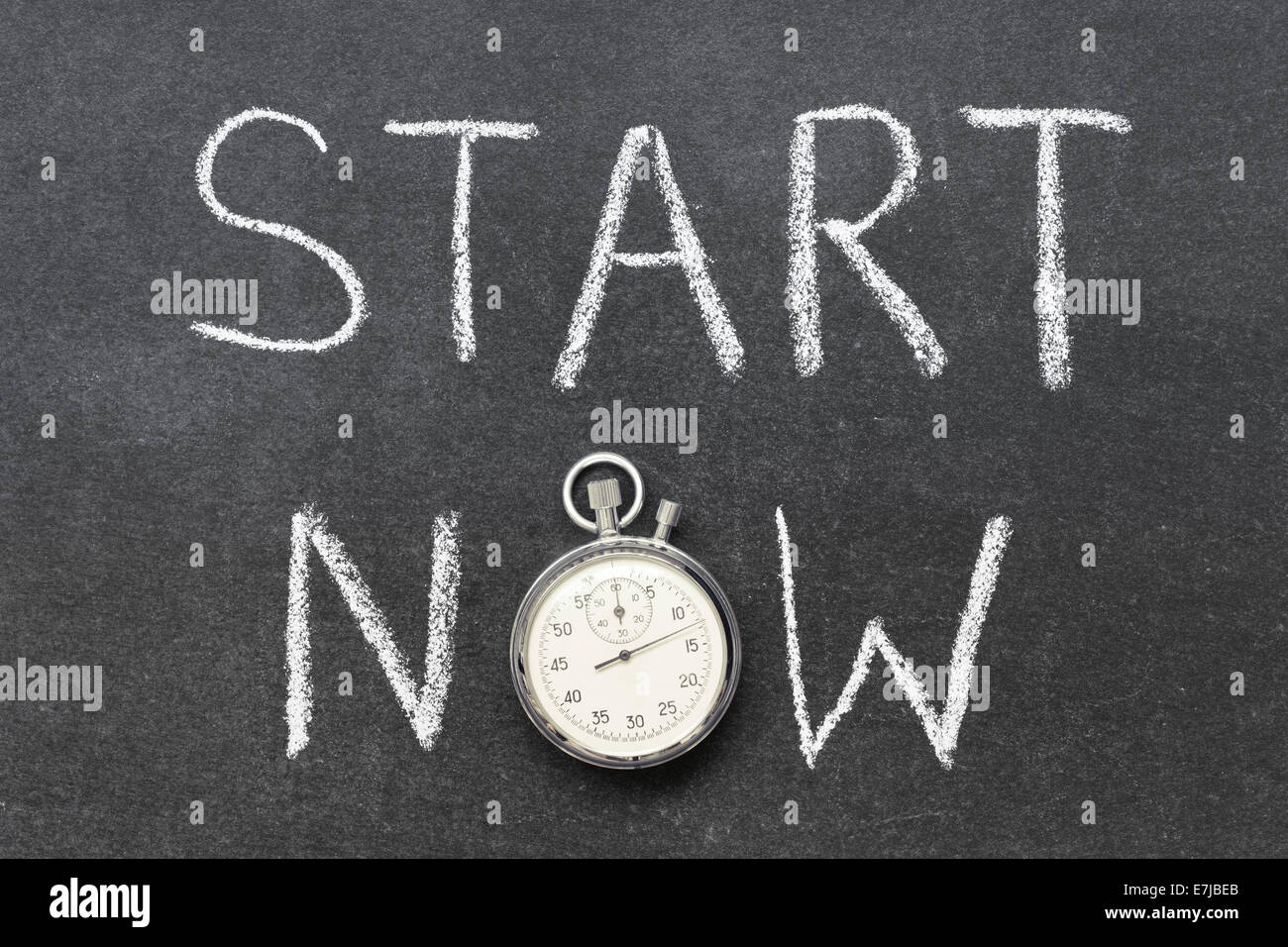 start now concept handwritten on chalkboard with vintage precise stopwatch used instead of O - Stock Image