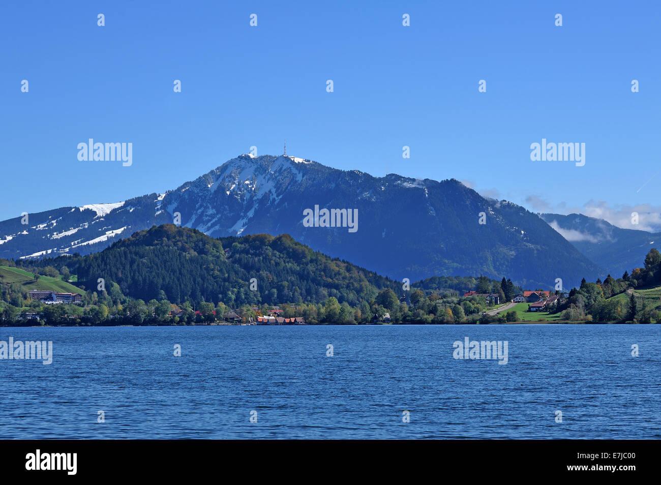 Snow-covered Grünten Mountain behind Alpsee lake, Upper Allgäu, Bavaria, Germany Stock Photo