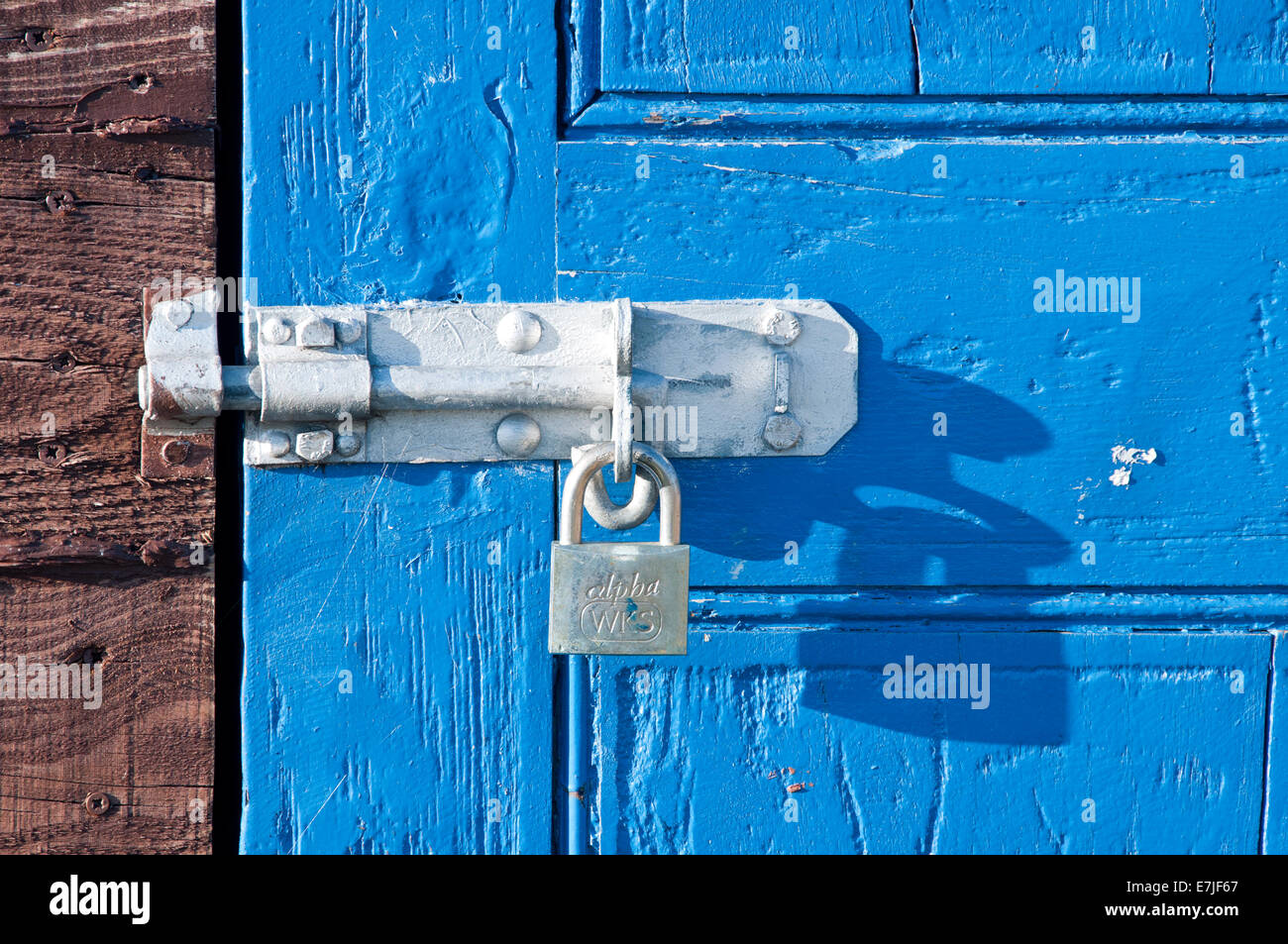 Padlock on Rustic Blue Boat Shed Door, Lindisfarne or Holy Island, Northumberland, England, UK Stock Photo
