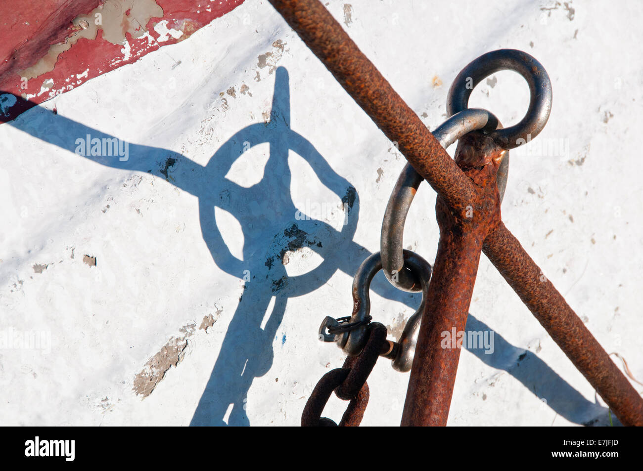 Rusted Anchor & Coble Boat Hull Cameo, Lindisfarne or Holy Island, Northumberland, England, UK - Stock Image