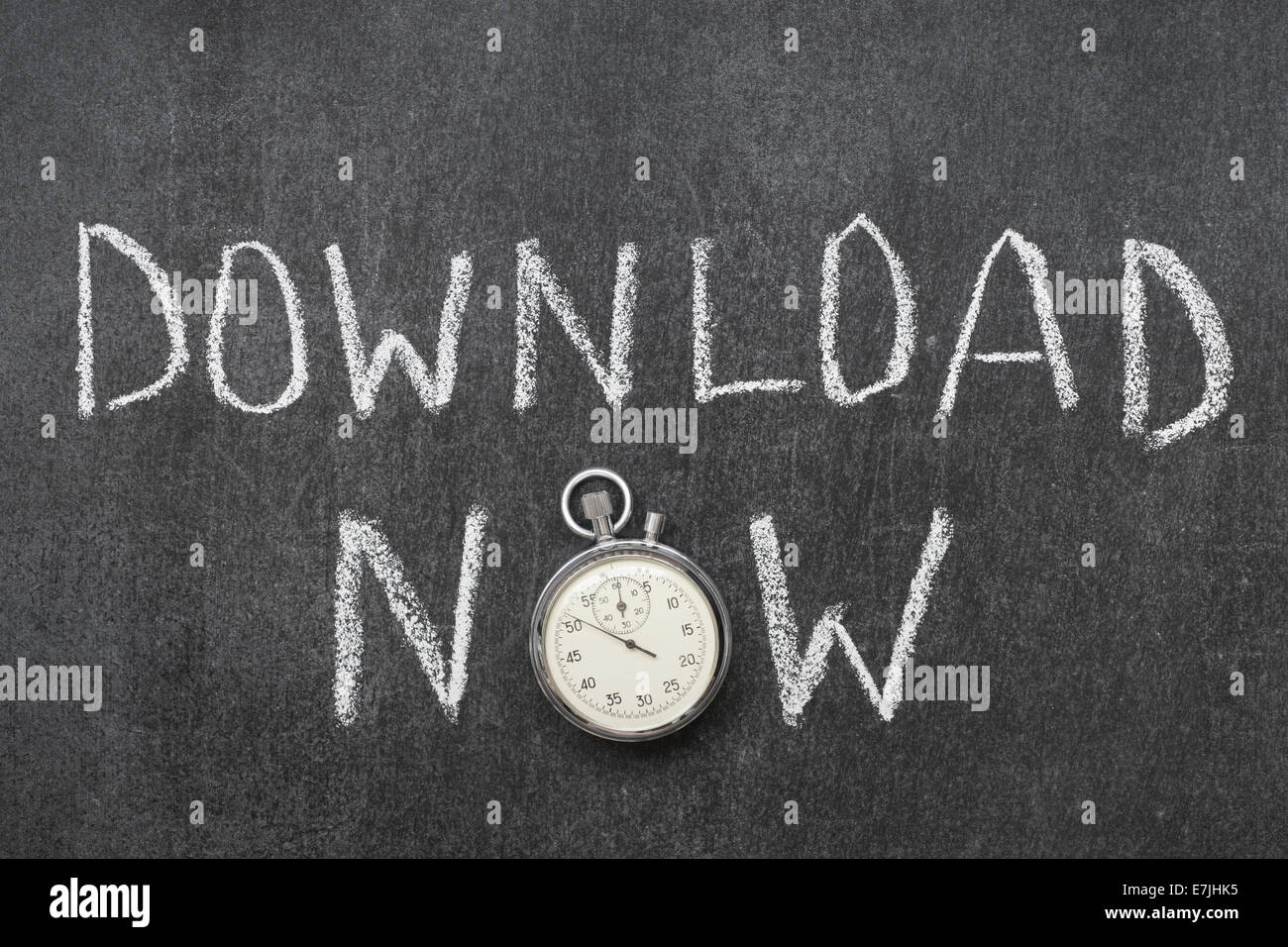 download now concept handwritten on chalkboard with vintage precise stopwatch used instead of O - Stock Image