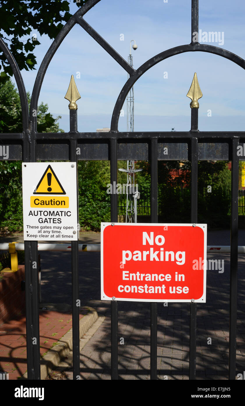 no parking notice in front of locked gates to offices and ...
