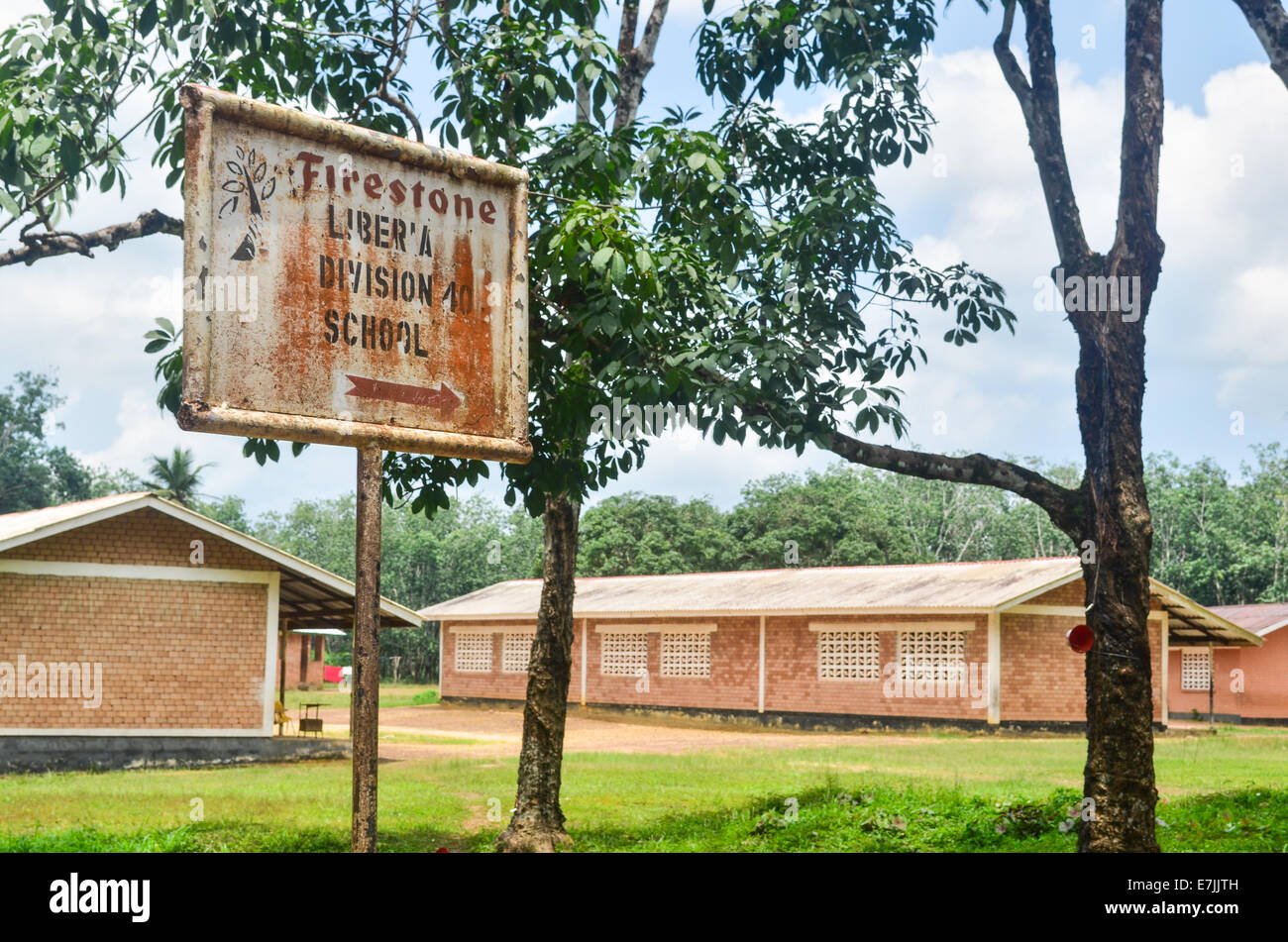 A school sign in the Firestone Natural Rubber Company giant plantation in Liberia - Stock Image