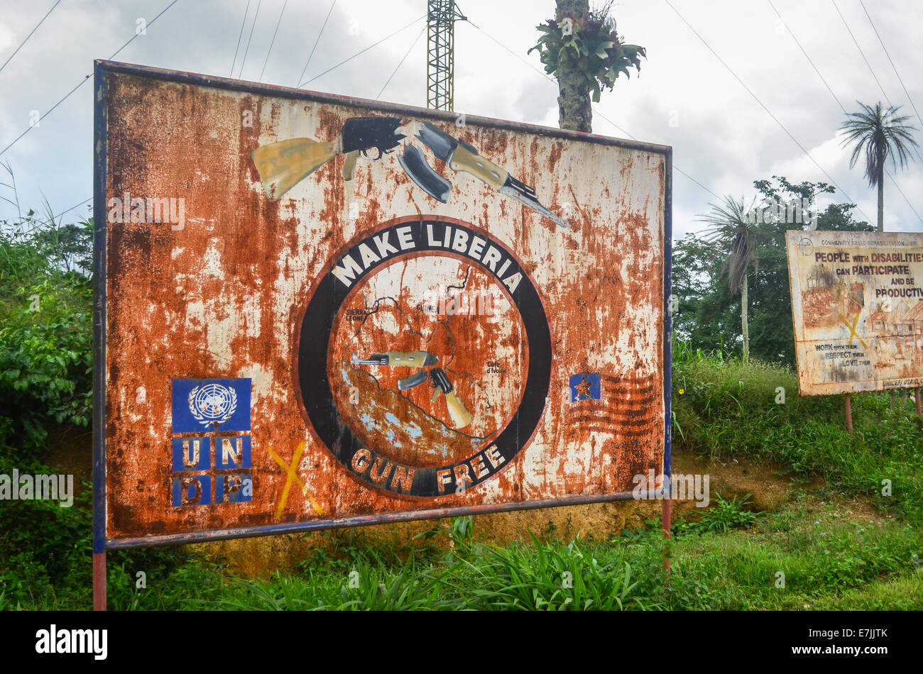 A rusty sign in Liberia reading 'Make Liberia gun free' by UNDP to deal with the civil war - Stock Image