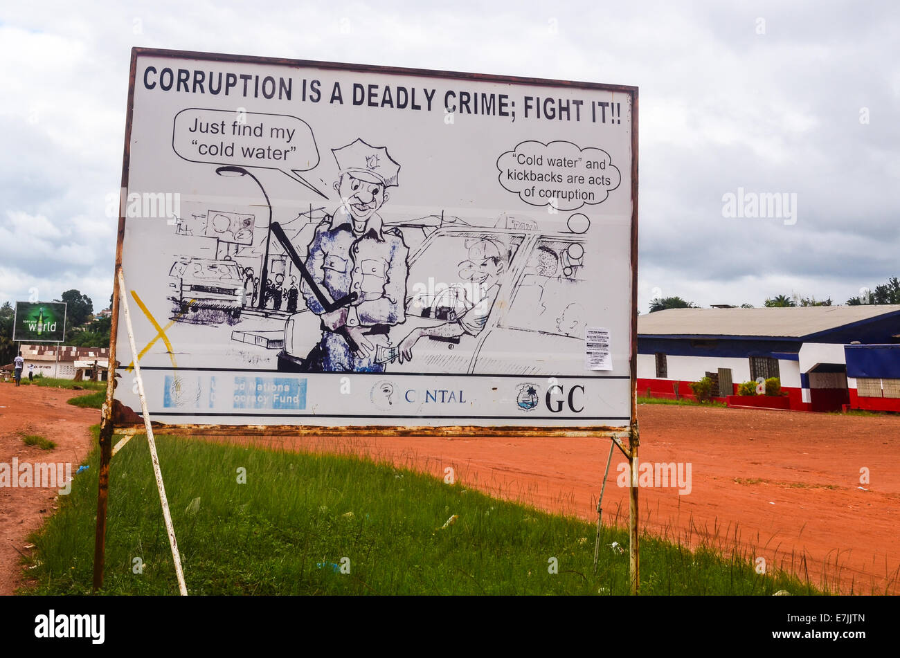 Road sign warning against corruption in Liberia, Africa - Stock Image