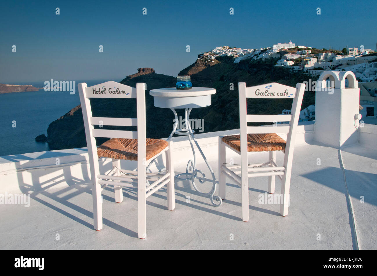 Hotel Galini Table & Chairs overlooking The Caldera,  Firostefani, Santorini, Cyclades, Greek Islands, Greece, - Stock Image