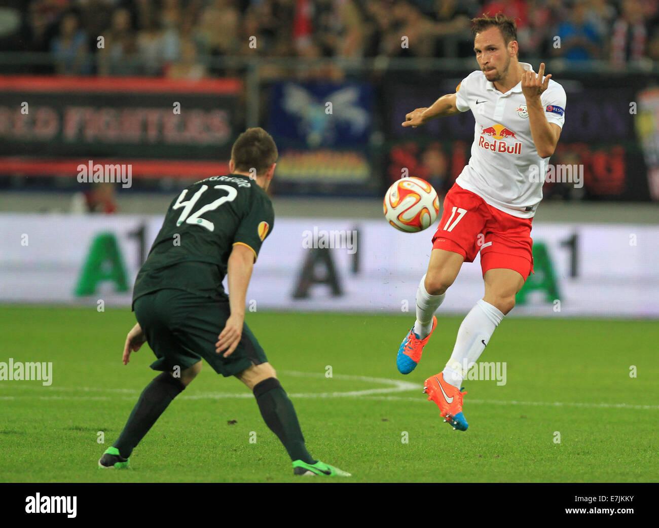 Salzburg, Austria. 18th Sep, 2014.Salzburg's Andreas Ulmer (r) vies for the ball with Celtic's Callum McGregor - Stock Image