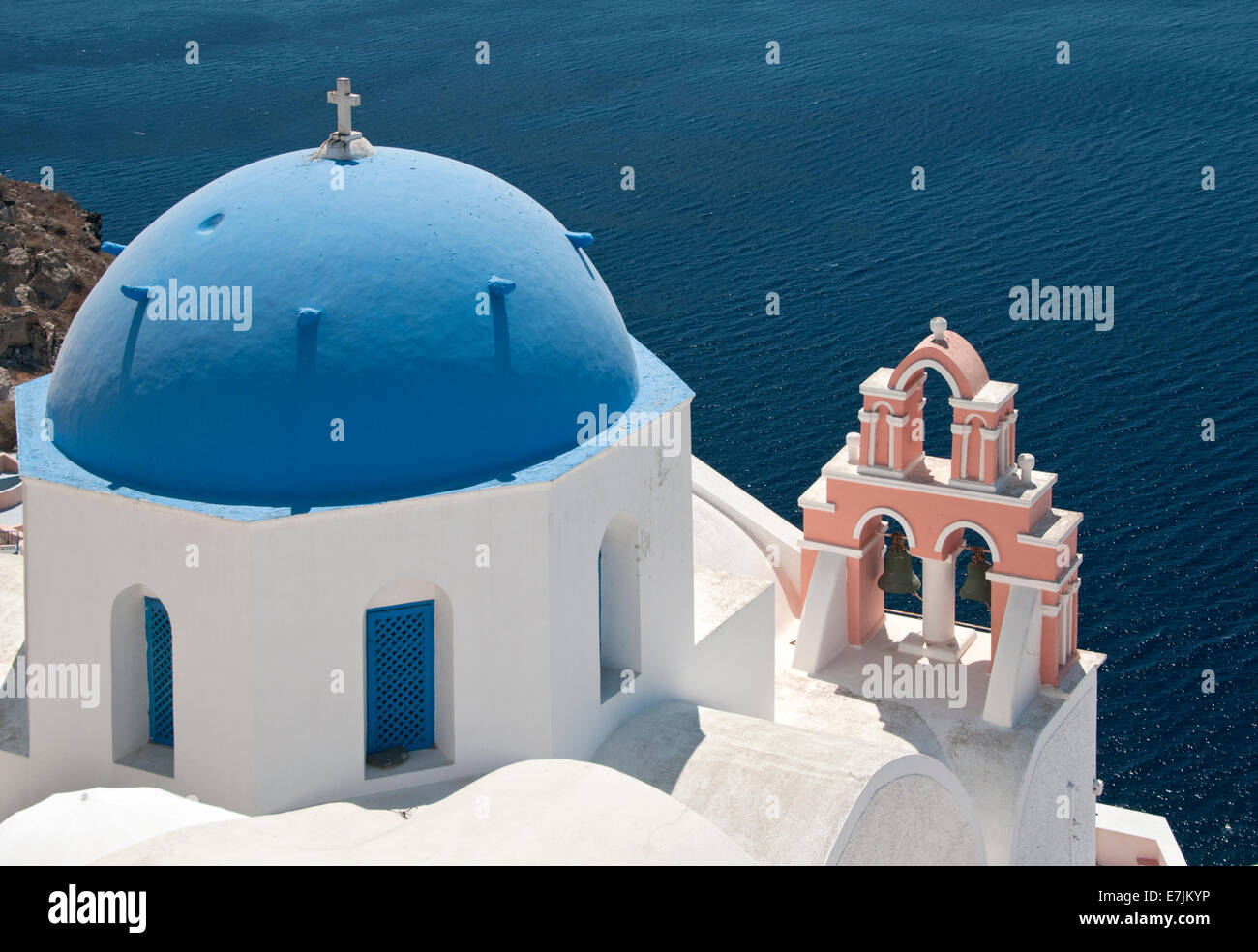 Blue Domed Churches Overlooking The Caldera, Oia, Santorini, Cyclades, Greek Islands, Greece, Europe - Stock Image