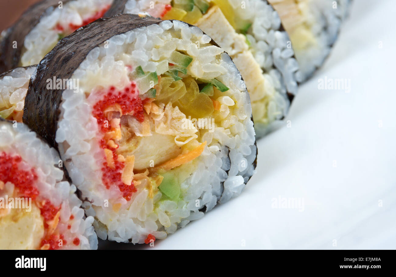 Japanese sushi.Roll made with chicken, eggs and vegetables - Stock Image