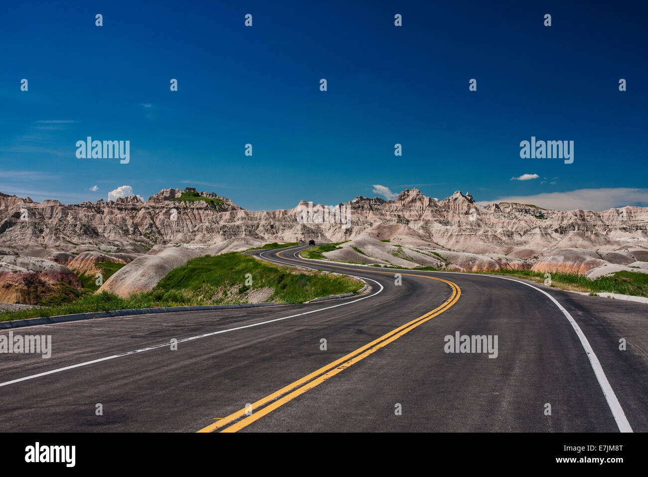 Where will the road take you, Badlands, North Dakota, driving through the rock formations of badlands national park - Stock Image