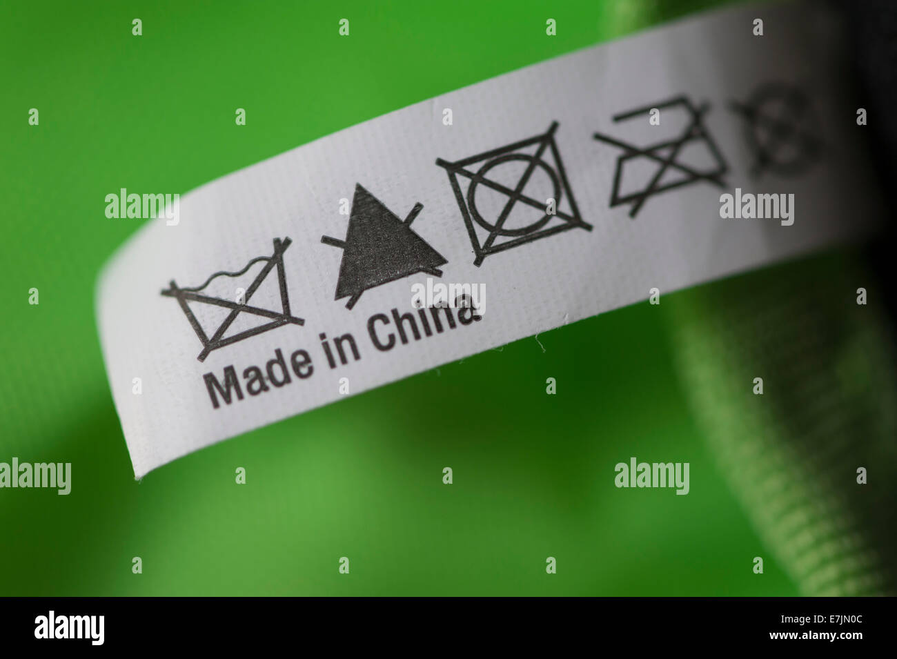 Close-up of a blurb labeled 'Made in China' on a piece of merchandise - Stock Image