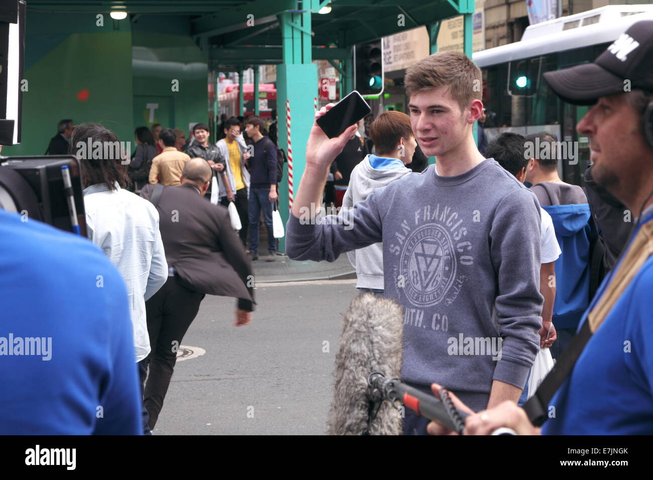 Sydney, Australia. 19th September, 2014. Young person showing off their new iphone 6 whilst being interviewed by Stock Photo