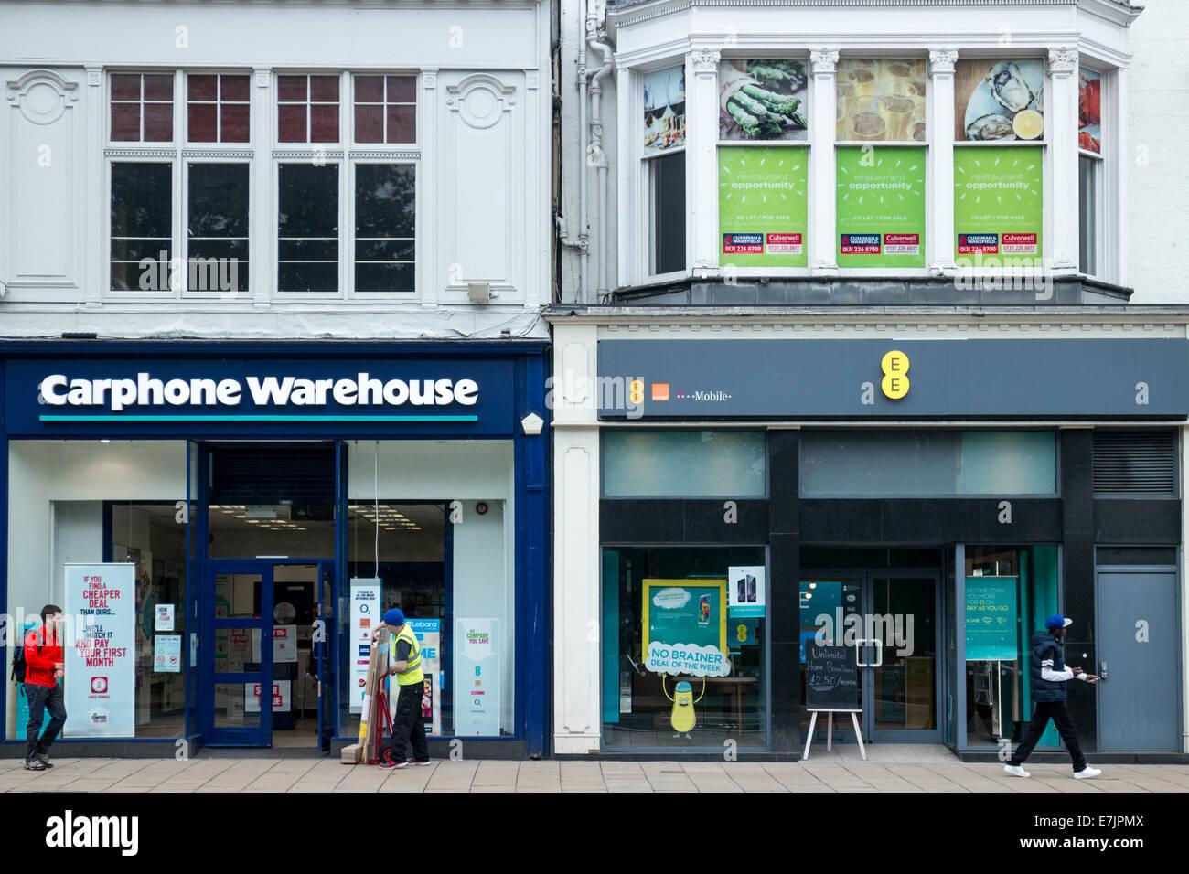 Carphone Warehouse and EE Everything Everwhere mobile phone shops on Princes Street, Edinburgh - Stock Image
