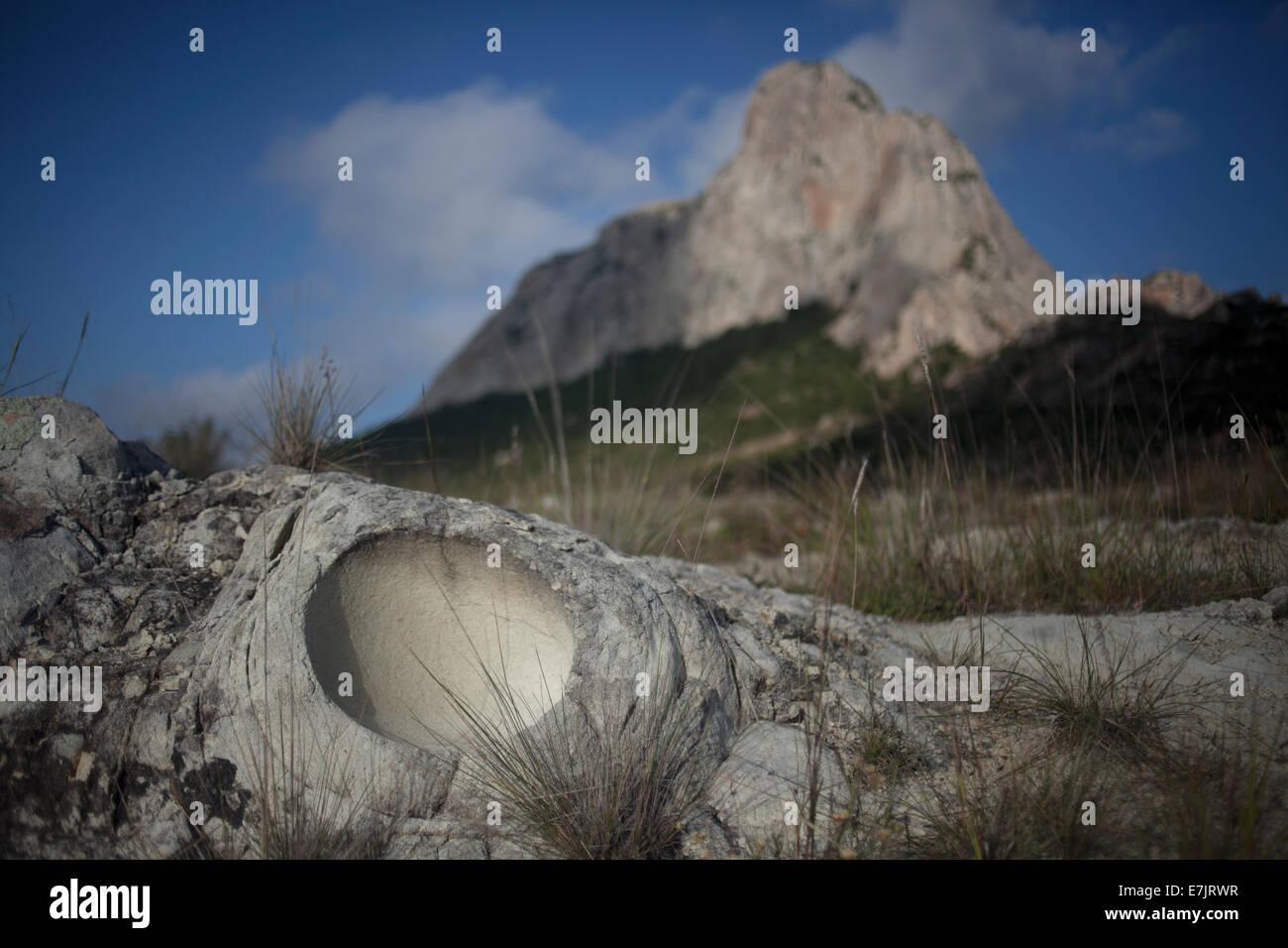 Fossilized imprint of a dinosaur egg in front of the Pena de Bernal monolithic mountain, San Sebastian Bernal, Queretaro, - Stock Image