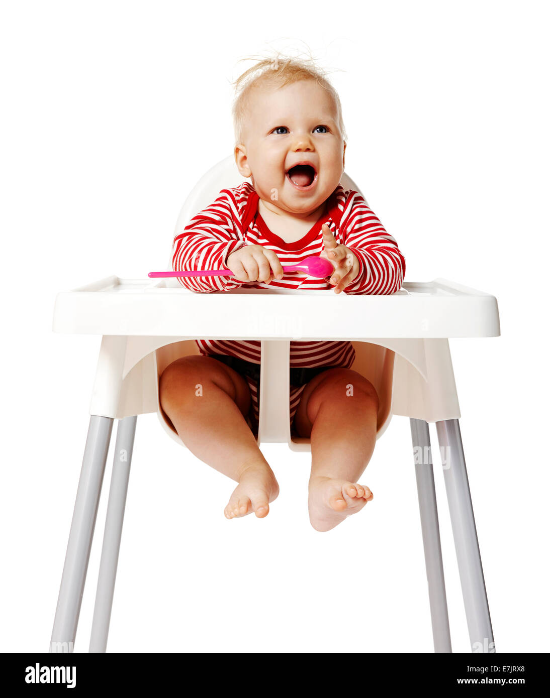 Baby sitting on chair and waiting for dinner. Isolated on white Background. - Stock Image