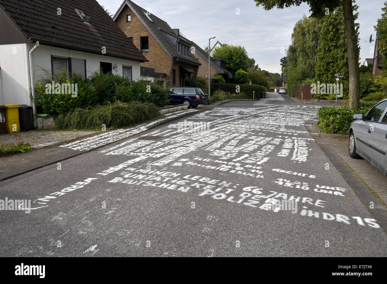 Writing on the road, a protest in a residential area in Germany. - Stock Image