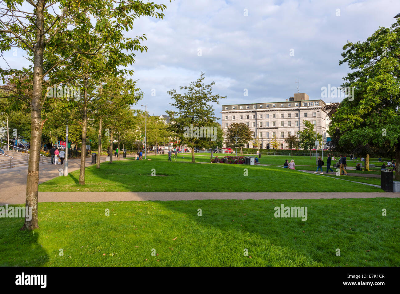 Early evening in Eyre Square looking towards the Hotel Meyrick, Galway City, County Galway, Republic of Ireland - Stock Image