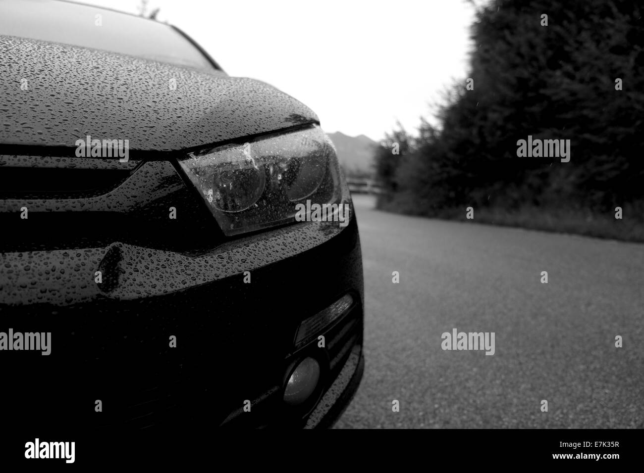Close-up of black VW Scirocco under the rain - Stock Image