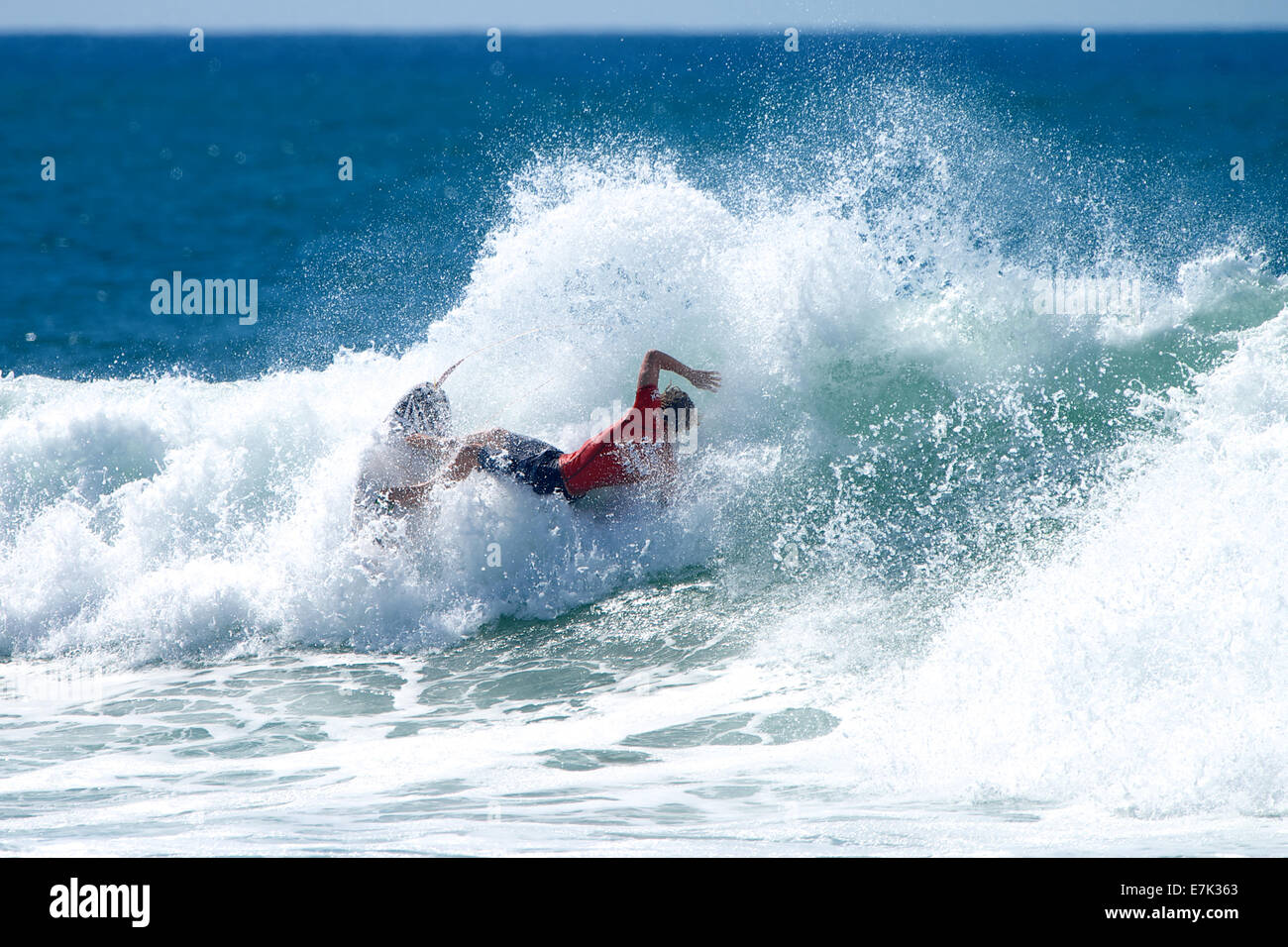Lower Trestles, California, USA. 18th September, 2014. Riding away from seemingly, impossibly stretched out maneuvers - Stock Image