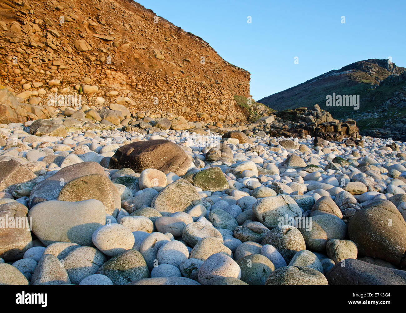 large round rocks found on the beach at Cot Cove near st.Just in Cornwall, UK - Stock Image