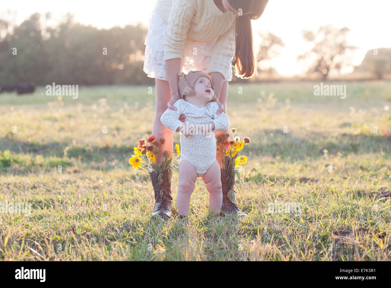Creative portrait of mother and baby in the field - Stock Image