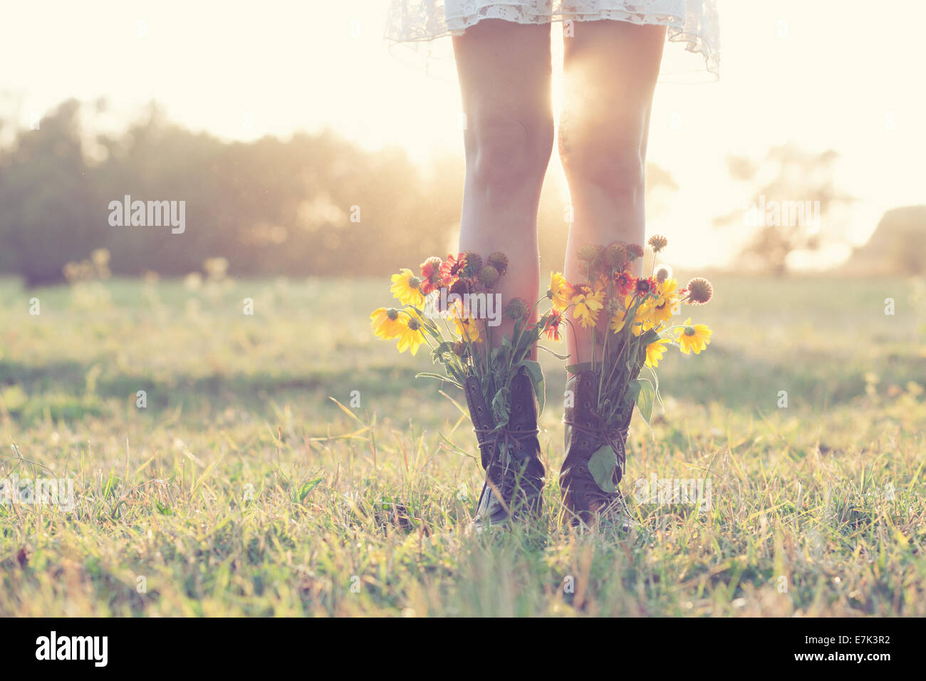 Creative bouquet in boots - Stock Image